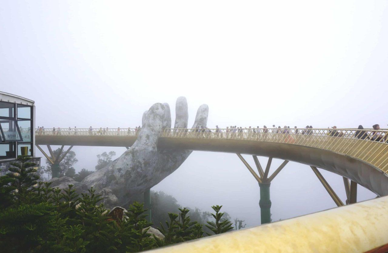 Golden bridge in the fog