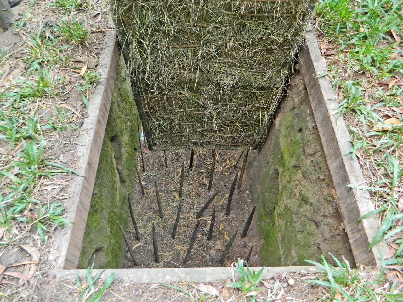 Spiked trap at the bottom of the well